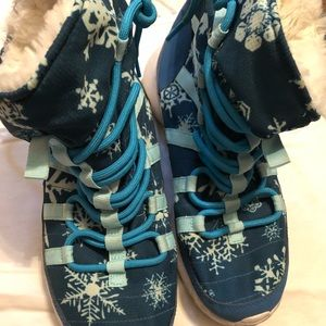 Used blue nike boots